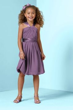 Youthful and fun, thiscrinkle chiffon and charmeuse short dress is perfect for the Junior Bridesmaid.   Y-neckline gives this dress a modern twist and adds interest.  Soft chiffon drapes beautifully into a bubble hem, while the charmeuse adds a touch of shine to the look.  Coordinates beautifully with any of our chiffon or charmeuse bridesmaid dresses.  This style features an adjustable fit foradded flexibility and comfort with fewer alterations.  Fully lined. Back zip. Imported