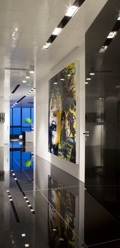 Nieto Design Group...hallway and art. Love the floors.