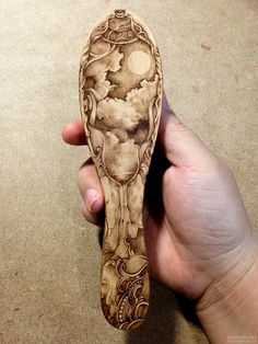 pyrography on wooden hair brush. wood burning.