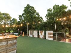 These giant love letters painted on pallets made a fun backdrop for the outdoor area at this marquee wedding