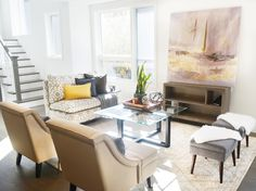 Modern, Eclectic, Cozy Living Room. Large Abstract warm pastel artwork, glass coffee table, printed settee, sheepskin accent