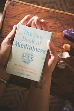 5-10 minute meditations, yoga poses, and intentions. Can read daily or at your own pace. I fell in love with this book and felt peace.