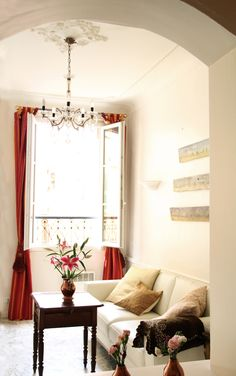 Charming Apartment with a sea view for rent In Old Nice. The apartment lies in a charming old building in Nice in the heart of the Old Town, two minutes from the beach and just off the flower market. It is filled with french charming details and decoration. #interior #france #Nice #oldtown #seaview #decor #chandelier #WallPainting #antique #french #vieuxnice #travel #visitfrance #FrenchRiviera #riviera #CotedAzur #CoursSaleya French Apartment, Visit France, Nice France, Cool Apartments, Old Building, Flower Market, Old Town, Old Things, Living Room