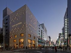 Louis Vuitton Matsuya Ginza Facade / Jun Aoki & Associates - This new Louis Vuitton store in Tokyo's fashionable Ginza shopping district, designed by Jun Aoki & Associates, with a patterned and perforated shell based on the brand's monogram. The panels mask the steel-framed reinforced concrete structure of the building beneath...