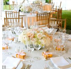 hydrangeas, roses, peonies, ranunculus and french sweet peas in shades of pink, peach, taupe and ivory.