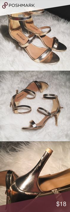 Gold strappy heeled sandals Gorgeous champaign gold strappy heeled sandals 😍 worn once but got a tiny scuff on the heel when I wore them. Not too noticeable! Practically new! Size 6 Shoes Sandals