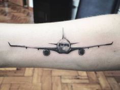 Black and Grey Airplane Tattoo by annacheukian