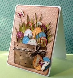 handmade card: Happy Easter ... by Delusional1 ... woven paper basket filled with die cut grass and egggs ... small patterned background paper ... country styling ... great card!!!