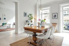 Antique table with modern chairs - using some modern chairs is a simple solution for bringing a space up to date.