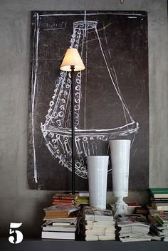 Using chalk, sketch an rough outline of something that you admire (like a chandelier) on a wall painted in chalkboard paint OR on a chalkboard mounted or leaning against your wall. This clever ideas is from Velvet, a cafe in Croatia designed by owner Saša Šekoranja.