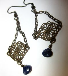 Classic dangly chandeliers in bronze and blue. From Vintaj brass chain and Vintaj filligree dangles a single genuine sapphire briolette. Wire used is coated bronze parawire. Nickel-free brass earwires and rubber backings.    Earring hang 2 3/4 inches from top of earwires.