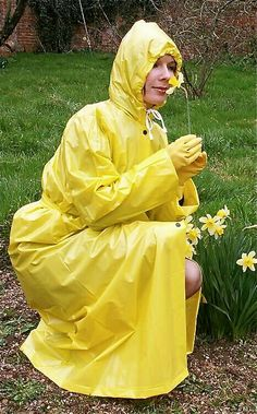 My yellow pvc mac matches the daffodils ! Vinyl Raincoat, Pvc Raincoat, Plastic Raincoat, Yellow Raincoat, Hooded Raincoat, Lorraine, Rain Bonnet, Rain Hat, Hooded Cloak