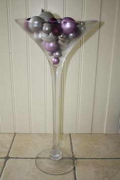 Our 50cm martini vase filled with various sizes of purple baubles. Perfect for Christmas events. #christmas #christmasparty