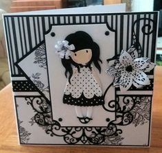 7x7 card. Papers are Craftwork Cards monochrome. Flower is a Tonic die and the little girl and fancy die are unbranded dies from China.