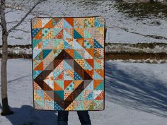 Love this half square triangle baby quilt