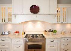 stone kitchen benchtops - Google Search - narrow shelf on face of rangehood for bottles of oil, salt & pepper.