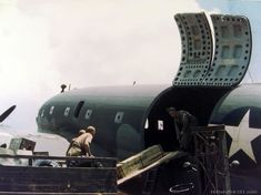 Unloading a Curtiss C-46 in China.