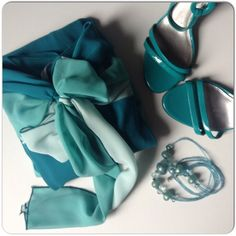 NWOT TEAL COLOR BLOCK COCKTAIL DRESS New teal color block cocktail dress in 3 shades of teal. The 2nd photo is most accurate of the colors. Single spaghetti straps, fully lined, aline chiffon overlay that drapes softly on the body. This is a beautiful piece for a waterfront wedding! The three shades of teal offer different styling options. Adding to the soft color & design is a front sash that can be tied in a bow or single knotted depending on your style. I went with the darker of the…