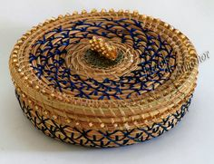 Blue and Gold this pine needle basket is all dressed up in blue and gold thread embellished with glass beads and a beaded bead knob.