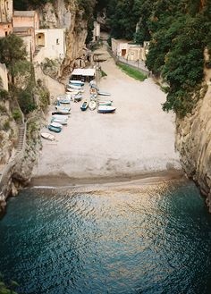 A tiny bay with boats on the beach In cinque terre Italy
