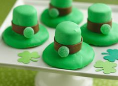 Sugar cookie, marshmallow, green tinted frosting, rolled out tootsie roll, and the top half of a small gum drop. (maybe an m&m would work?) Simple and cute, too.