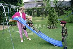 July 18, 1986: Princess Diana with Prince William and Prince Harry dressed in the uniforms of the Parachute Regiment of the British Army in the garden of Highgrove House in Gloucestershire.