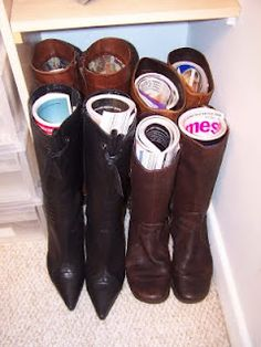the easiest way to store boots: magazines inserted to preserve their shape!!! from The Linen Cupboard