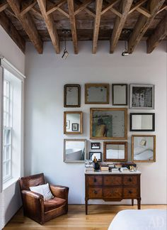 Vintage chair. Antique chest of the XVIII century. On the wall installation 12 Moi, invented by Etienne Benjamin. | Wall decoration | admagazine