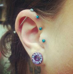 I like this...2 forward helix piercings with an industrial making a mock triple forward helix