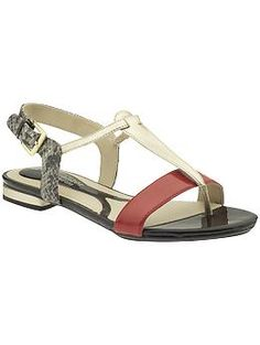 red, gold, and snake skin sandals....