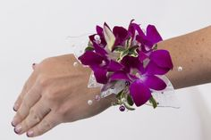 Our All Orchid Wrist Corsage comes with a elastic Pearl Wristlet (Not Shown In this Photo). Please call Soderberg's Floral at 612-724-3606 to have our designers create a custom design for you. Multipule Colors are available. White, Fuchia, Green, Purple and Fuchia/White. All corsages can be upgraded to all rhinestone wristlet which is a great keepsake!
