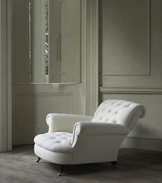 the leaning armchair. perfect for legs to curl up on. via roseuniacke.com