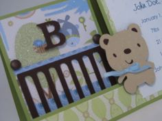 """sample-baby announcement card.  Sweet, baby boy themed easel card adorned with crib, """"wall paper"""" and teddy bear accent.  Style and colors can be customized especially for your new little one!"""