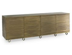 Brass is making a come back! Look how great this brass finish looks on this cabinet piece. #design #brasscabinet
