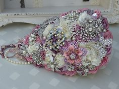 Brooch shower bouquet in ivory, pinks and blush shades
