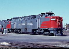 SP's German K-M hydraulic 9002 basks in the sun at Sacramento, Calif. but don't be deceived in thinking the K-M's had 4-wheel trucks. A low tie-rod or truck component creates a shadow that hides the center wheels in this sunny photo on March 13, 1964. The 9002 lasted only six years.