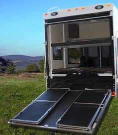 """HappiJac Power Bed Lift - Utilizes vertical space to store queen sized bed. The """"Bunk Bed Option"""" supports up to two queen size beds in a double bunk bed configuration. Beds can be raised up and out the way while storing or hauling ATV's or other equipment and lowered again for use when needed. The """"Sofa Option"""" can accommodate one reversible sofa or a sofa-single bunk combination."""