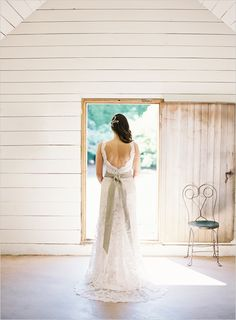 Jim Hjelm wedding gown with a sage green wedding sash