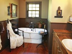 The master bathroom features a soaking tub, a dry sink