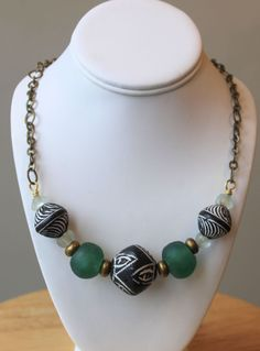 Handmade necklace by Susan Pauls, available at Northland Exposure Artists' Gallery, Parkville, MO. Materials: Brass, clay beads, glass beads (sold but similar available)