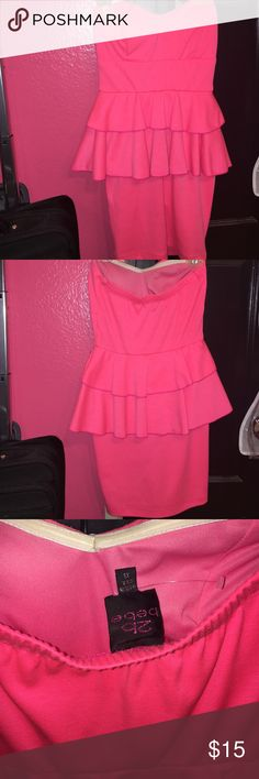 Beautiful neon peplum dress Just sitting in the closet! Worn once to a birthday. Neon pink💅🏻 great condition. Will wash before shipping! Extremely firm fitting! Accentuates curves and just looks so cute! Padding on chest area as well. Brand: 2B Bebe bebe Dresses Mini