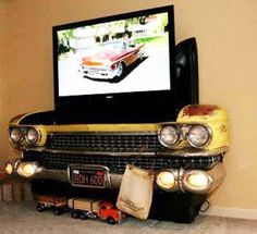 Now I can watch widescreen TV on a modified '59 Cadillac hood. It will go perfectly with the '59 Cadillac sofa and the VW Bus pool table. Santa better bring a big truck to deliver them all to my house. If Santa brings this yellow Caddie to me, I promise that I'll touch up the paint.