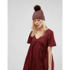 ASOS Mauve Rib Beanie With Chocolate Faux Fur Pom (21485 IQD) ❤ liked on Polyvore featuring accessories, hats, pink, pink beanie hat, pompom hat, pom pom hat, brimmed beanie hats and pom pom beanie