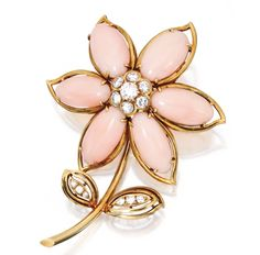18 KARAT GOLD, CORAL AND DIAMOND BROOCH, VAN CLEEF & ARPELS Of floral design, the petals composed of six coral cabochons, accented by round diamonds weighing approximately 1.70 carats, signed Van Cleef & Arpels N.Y., numbered 1V855-1.