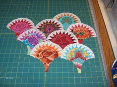 Inklingo Projects: Pickled Clamshells. Kaffe Fassett fussycuts, hand piecing on squares.