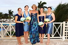 Bridesmaid dresses (designed by each girl as desired) by Anna Elyse Bridesmaids. Mother of the Bride in Nicole Miller. Perfect blues for Mexico!