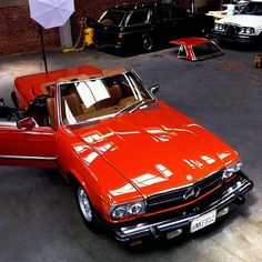 Mercedes Benz 450 SL - my dad had this car, in a much deeper Ferrari red. I took it to prom.