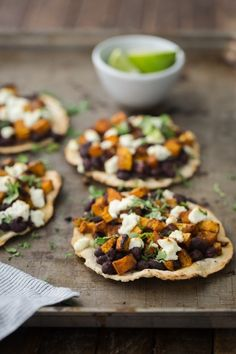 Skip the cheese! A perfect intro to fall, these black bean tostadas are topped with a chipotle butternut squash and goat cheese then served with a squeeze of lime juice . Mexican Food Recipes, Whole Food Recipes, Vegetarian Recipes, Cooking Recipes, Healthy Recipes, Onion Recipes, Veg Recipes, Cooking Tips, Buffet