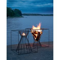 Gather Around These 7 Modern Fire Pit Designs - Photo 2 of 7 - The Boo Fire Basket from Skargaarden is made of black lacquered steel. Designed to fit several logs for an outdoor fire, the Boo can also be overturned to hold a candle or lantern. Outdoor Fire, Outdoor Living, Outdoor Decor, Outdoor Spaces, Outdoor Furniture, Fire Basket, Modern Fire Pit, Freestanding Fireplace, Fire Pit Designs