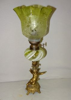 Lot: Unusual French Cupid Kerosene Lamp & Shade, Lot Number: 0089, Starting Bid: $100, Auctioneer: Danny's Auction, Auction: Danny's 37th Annual New Year's Day Auction, Date: January 1st, 2016 EST